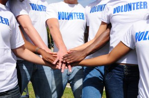 volunteer group join hands